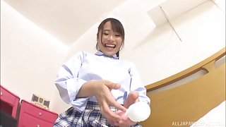 Japanese solo model in a miniskirt Haruno Rumi plays with herself